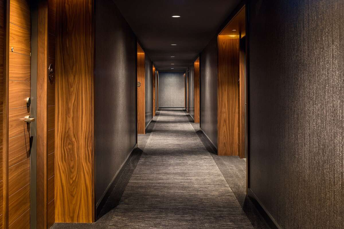 Rich woods in hallways at Vancouver�s new Douglas hotel recall the role of Douglas fir in building the city.