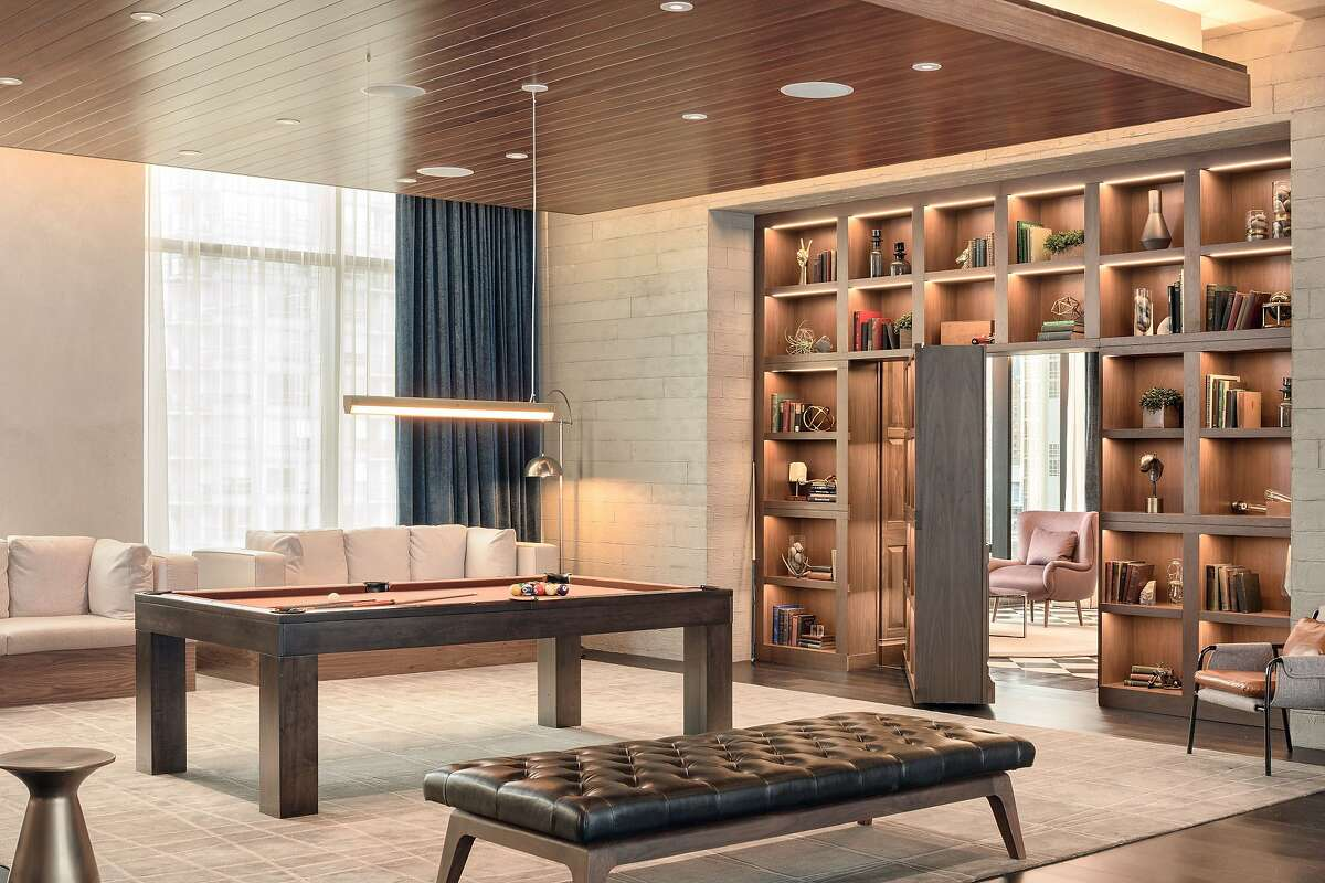 The Douglas, one of two Marriott hotels in the new Parq Vancouver casino and dining complex, features a living room-style lobby with bar and access to a sixth-floor park with more than 200 native pines.