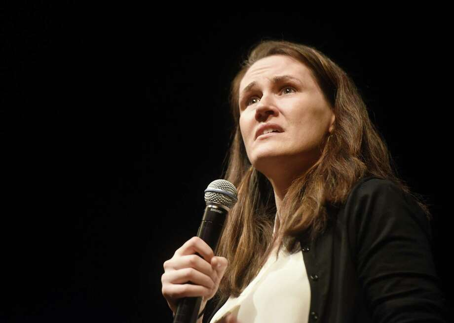 "Author and motivational speaker Liz Murray speaks at Greenwich Academy  in Greenwich, Conn. Monday, Jan. 8, 2018. Murray grew up in the Bronx to drug-addicted parents and was homeless at age 15, but was accepted to Harvard despite her obstacles. She is the author of the bestselling memoir ""Breaking Night,"" which tells the story of her life growing up and rise to success. Photo: Tyler Sizemore / Hearst Connecticut Media / Greenwich Time"