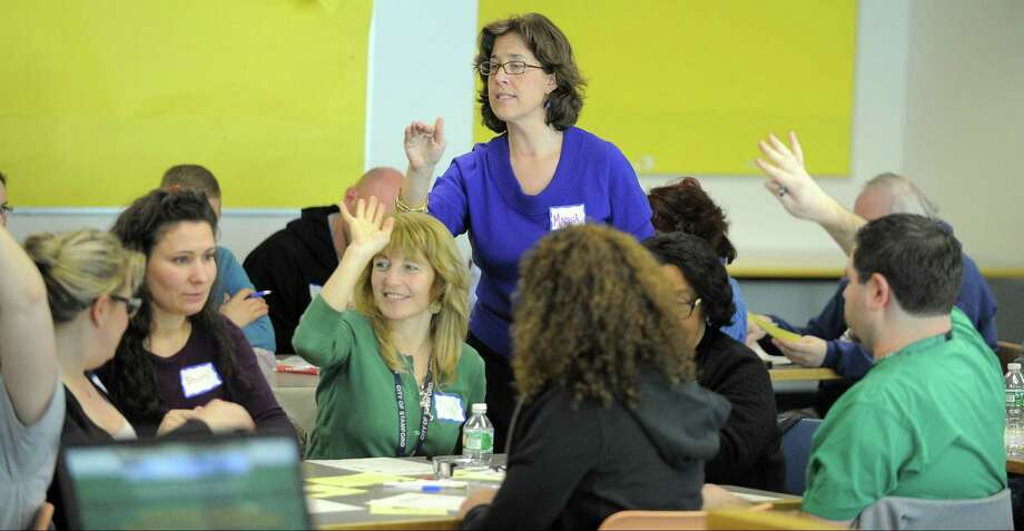 FILE — Marisa Ferraro teaches a lesson in German to Stamford educators during a class at the Stamford Government Center. The state budget eliminated funding for a program that mentors new public school teachers, but kept the requirement in place, leaving districts to foot the bill. Photo: Hearst Connecticut Media File Photo / Stamford Advocate