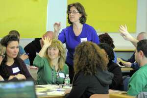FILE — Marisa Ferraro teaches a lesson in German to Stamford educators during a class at the Stamford Government Center. The state budget eliminated funding for a program that mentors new public school teachers, but kept the requirement in place, leaving districts to foot the bill.
