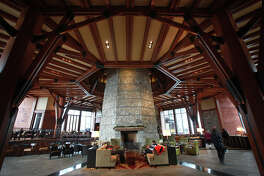 Cozy seating areas surround the stone fireplace column at the Ritz-Carlton Lake Tahoe November 16 2012.