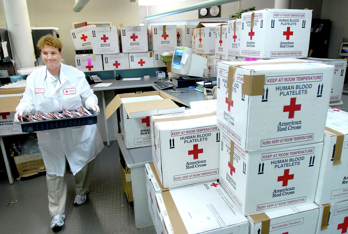 FILE - Product management technician Jill Husbands restocks bags of blood at the American Red Cross processing center in Farmington in 2007. Photo by Arnold Gold