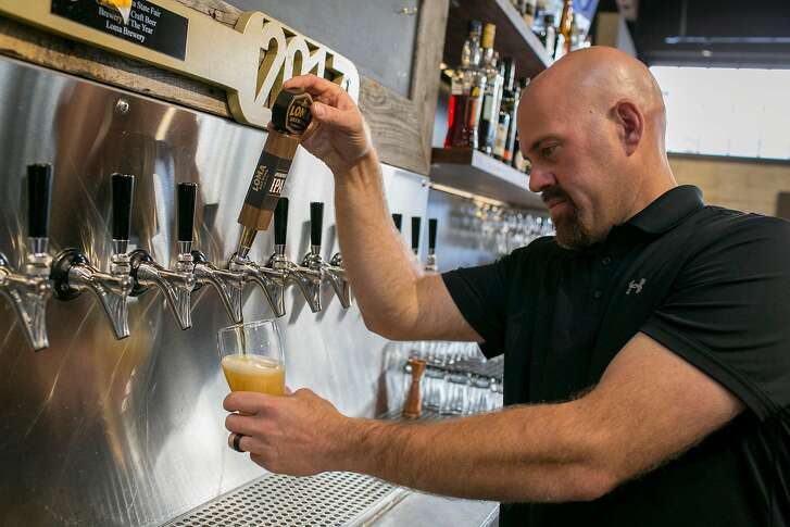 Kevin Youkilis pours a glass of Appeasement IPA, one of the award winning beers at Loma Brewing Co. In Los Gatos, Calif. Kevin Youkilis, a former major-leage baseball player for the Boston Red Sox, took over the Los Gatos Brewing Co. and reopened as Loma Brewing Co. with partners. Brian Feulner, Special to the Chronicle