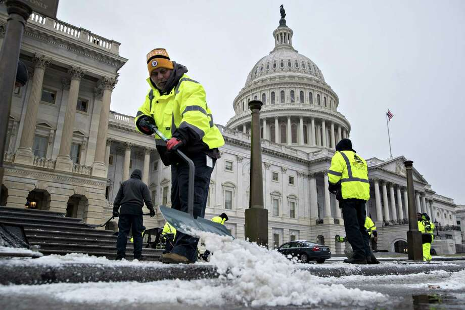 Workers shovel snow outside the U.S. Capitol in Washington on Jan. 4.  (Bloomberg photo by Andrew Harrer) Photo: Andrew Harrer / © 2018 Bloomberg Finance LP