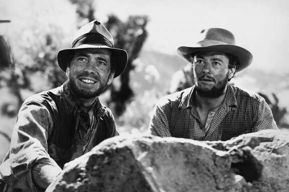 Actors Humphrey Bogart and Tim Holt pose for a publicity still for the Warner Bros/First National film 'The Treasure of the Sierra Madre.' (Photo by Donaldson Collection/Michael Ochs Archives/Getty Images)