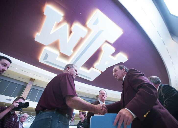 New Texas A&M University head football coach Jimbo Fisher greets well-wishers following a press conference at the school's Hall of Champions at Kyle Field, Monday, Dec. 4, 2017, in College Station. ( Mark Mulligan / Houston Chronicle )
