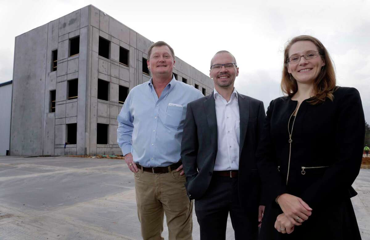 Keith Dalton, of Houston-based developer KDW; Hoger Heichel, Bauer Pileco director; and Maret Petersson, German American Chamber of Commerce, at the construction site of the new Bauer Pileco manufacturing facility in Conroe, TX, Dec. 22, 2107. (Michael Wyke / For the Chronicle)