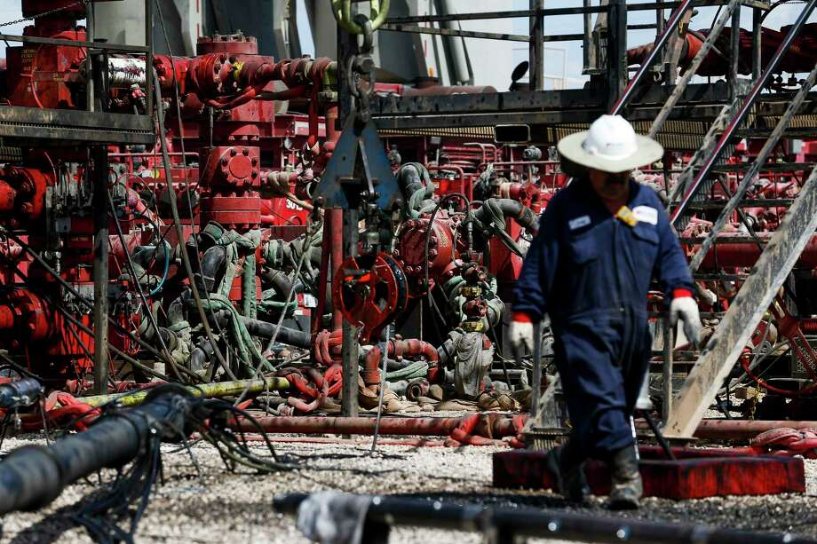 An employee walks by pressure pumps before hydraulic fracturing operations begin at a Chevron drilling site Wednesday, July 19, 2017 in Midland. Photo: Michael Ciaglo, Houston Chronicle / Michael Ciaglo