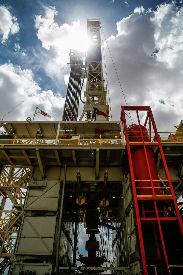 A drilling rig sits on a pad site where it will drill three to six wells next to each other at a Chevron drilling and hydraulic fracturing site Wednesday, July 19, 2017 in Midland. Photo: Michael Ciaglo, Houston Chronicle / Michael Ciaglo