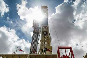A drilling rig sits on a pad site where it will drill three to six wells next to each other at a Chevron drilling and hydraulic fracturing site Wednesday, July 19, 2017 in Midland.