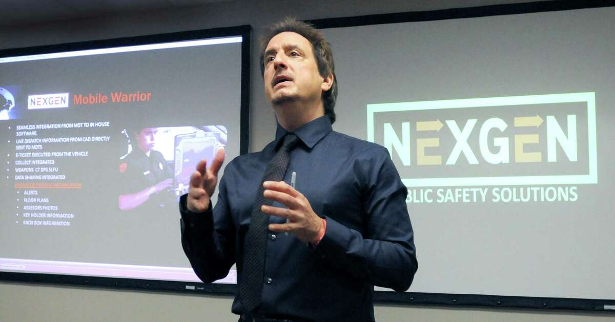 Sal Annunziato, CEO of NexGen, a software company that develops Public Safety software for Connecticut Police and Fire Departments, as he launches a demonstration iPhone and iPad compatible mobile version of their pubic safety software as well as recognizing state legislators with awards Wednesday September 25, 2012 at NexGen headquarters in East Haven, Connecticut. Photo by Peter Hvizdak / New Haven Register