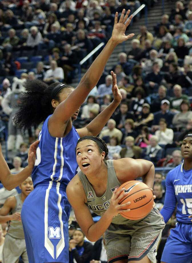 Connecticut's Napheesa Collier (24) works her way to the basket during the first half of an NCAA college basketball game against Memphis Sunday, Dec. 31, 2017, in Hartford, Conn. UConn won, 97-49. (AP Photo/Stephen Dunn) Photo: Stephen Dunn / Associated Press / FR171426 AP