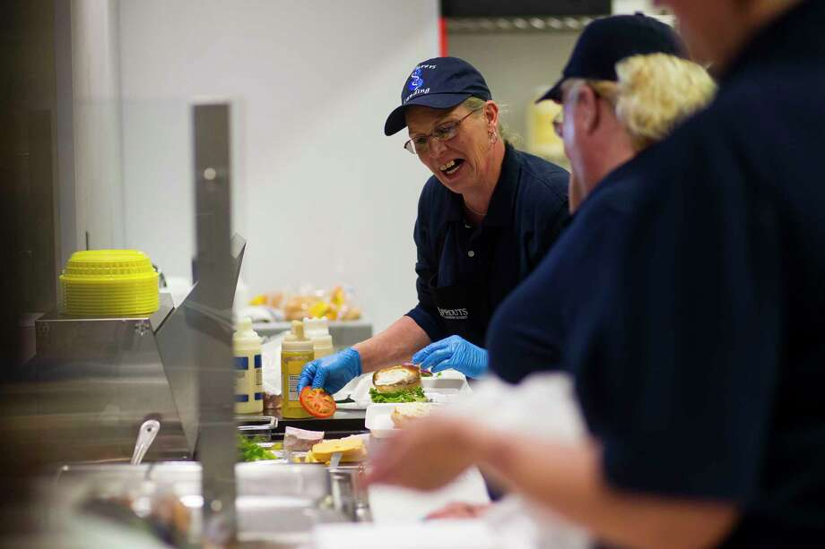 Hamburgers are built at the Seafarers Landing restaurant inside the Howard T. Tellepsen Seafarers' Center's new location inside the Port of Houston, Monday, Jan. 8, 2018, in Houston. ( Mark Mulligan / Houston Chronicle ) Photo: Mark Mulligan, Houston Chronicle / © 2018 Houston Chronicle