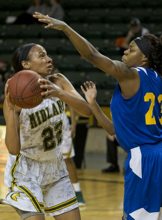 Midland College's Paige Robinson looks to put up a shot as Frank Phillips' Kiara Shoals defends 01/08/18 at the Chaparral Center. Tim Fischer/Reporter-Telegram Photo: Tim Fischer/Midland Reporter-Telegram