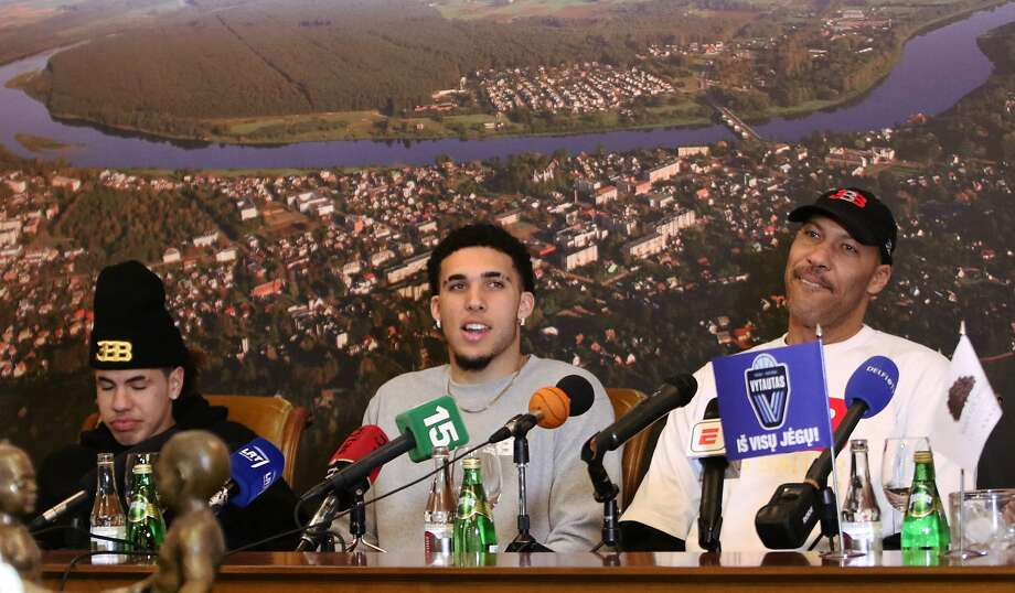 US basketball player (L-R) LaMelo Ball, LiAngelo Ball and their father LaVar Ball attend a press conference in Prienai, Lithuania, where they will play for the Vytautas club on January 5, 2018. Basketball-crazed Lithuania welcomed LiAngelo and LaMelo Ball, the two youngest sons of flamboyant Los Angeles entrepreneur LaVar Ball who recently made headlines due to a feud with US President Donald Trump. / AFP PHOTO / Petras MalukasPETRAS MALUKAS/AFP/Getty Images Photo: PETRAS MALUKAS, AFP/Getty Images