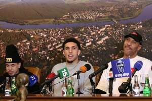 US basketball player (L-R) LaMelo Ball, LiAngelo Ball and their father LaVar Ball attend a press conference in Prienai, Lithuania, where they will play for the Vytautas club on January 5, 2018. Basketball-crazed Lithuania welcomed LiAngelo and LaMelo Ball, the two youngest sons of flamboyant Los Angeles entrepreneur LaVar Ball who recently made headlines due to a feud with US President Donald Trump. / AFP PHOTO / Petras MalukasPETRAS MALUKAS/AFP/Getty Images