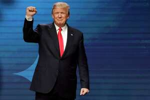 President Donald Trump acknowledges applause after speaking at the American Farm Bureau Federation annual convention Monday, Jan. 8, 2018, in Nashville, Tenn. (AP Photo/Mark Humphrey)