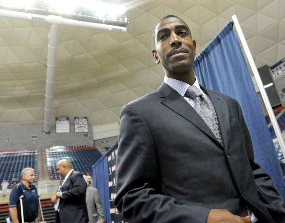 "Sept. 13, 2012:After two seasons as Jim Calhoun's assistant and with no prior head coaching experience at any level, Kevin Ollie is named UConn's 18th men's basketball head coach. At a dual press conference announcing Calhoun's retirement and Ollie's hire, Ollie steals the show, spinning what will become known as ""Ollie-isms"" like ""We're gonna take the stairs"" and ""ten toes in"" to wow the crowd and usher in a new era. Speaking with Jim Calhoun is Ward Manuel, UConn's Director of Athletics. Photo: Peter Hvizdak, New Haven Register / ©Peter Hvizdak /  New Haven Register"