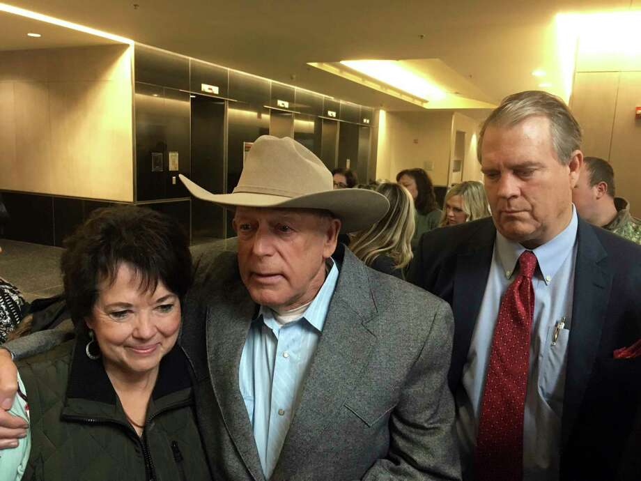 Rancher Cliven Bundy, center, emerges Monday, Jan. 8, 2018, flanked by his wife, Carol Bundy, left, and attorney Bret Whipple, right, from the U.S. District Court building in Las Vegas. A judge in Las Vegas on Monday dismissed criminal charges against the Nevada rancher and his sons accused of leading an armed uprising against federal authorities in 2014. (AP Photo/Ken Ritter) Photo: Ken Ritter, STF / Copyright 2018 The Associated Press. All rights reserved.