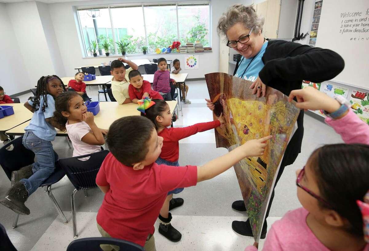 Art teacher Carolyn Jackson showcases a picture of Gustav Klimt's