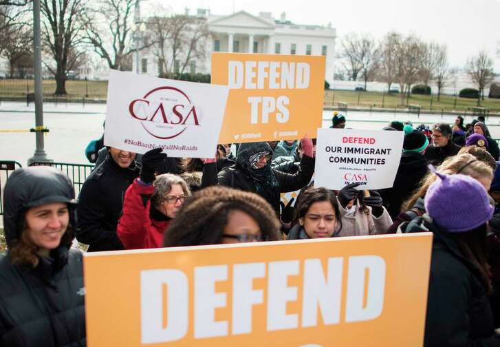 Salvadoran immigrants and activists protest the decision Monday near the White House.