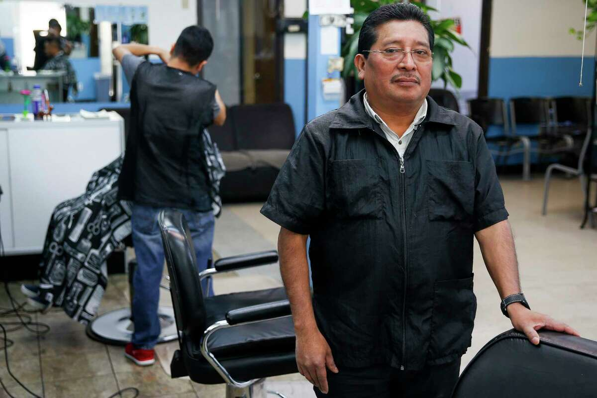 Silverio Perez, owner of a beauty salon in southwest Houston, has been in the U.S. for 26 years.