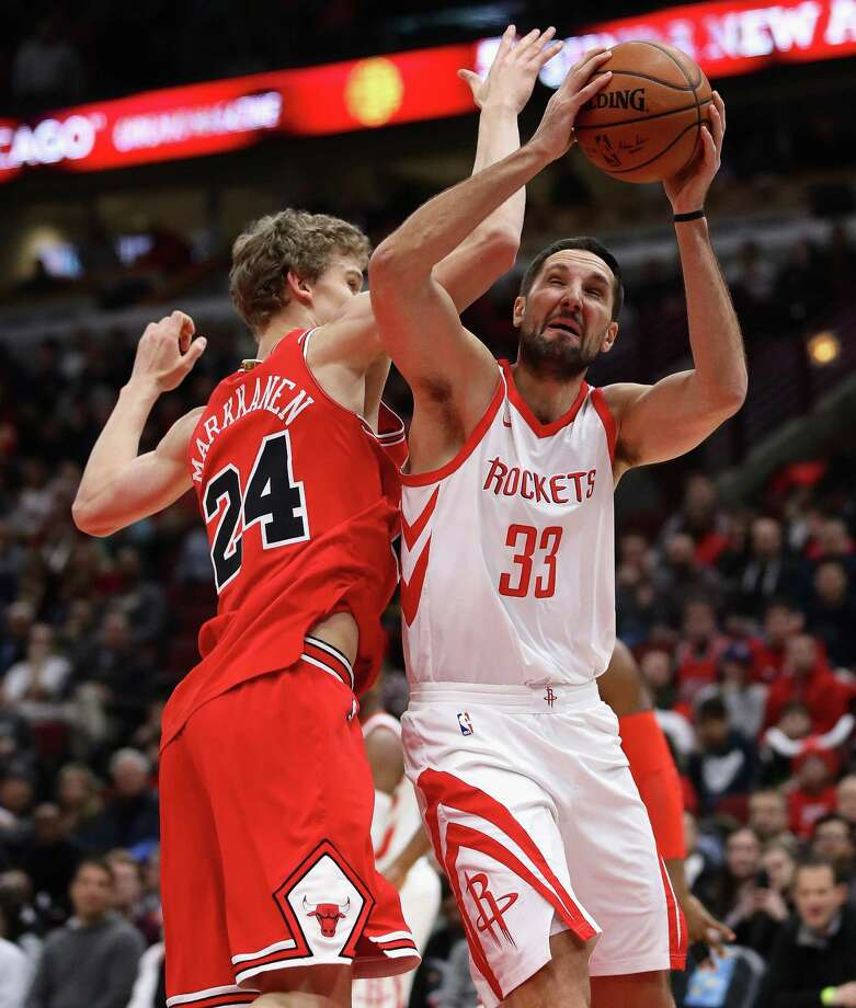 CHICAGO, IL - JANUARY 08:  Ryan Anderson #33 of the Houston Rockets is fouled while shooting by Lauri Markkanen #24 of the Chicago Bulls at the United Center on January 8, 2018 in Chicago, Illinois. NOTE TO USER: User expressly acknowledges and agrees that, by downloading and or using this photograph, User is consenting to the terms and conditions of the Getty Images License Agreement. Photo: Jonathan Daniel, Getty Images / 2018 Getty Images