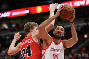 CHICAGO, IL - JANUARY 08:  Ryan Anderson #33 of the Houston Rockets is fouled while shooting by Lauri Markkanen #24 of the Chicago Bulls at the United Center on January 8, 2018 in Chicago, Illinois. NOTE TO USER: User expressly acknowledges and agrees that, by downloading and or using this photograph, User is consenting to the terms and conditions of the Getty Images License Agreement.