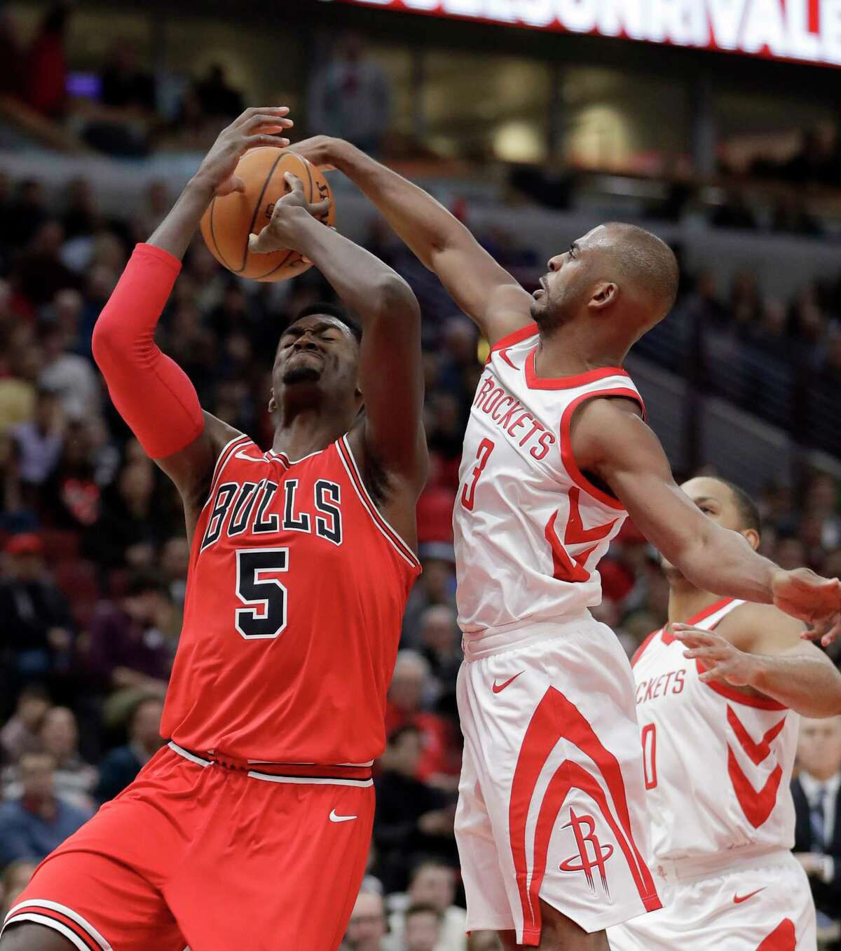 Houston Rockets' Chris Paul, front right, blocks the shot of Chicago Bulls' Bobby Portis, left, during the second half of an NBA basketball game Monday, Jan. 8, 2018, in Chicago. (AP Photo/Charles Rex Arbogast)