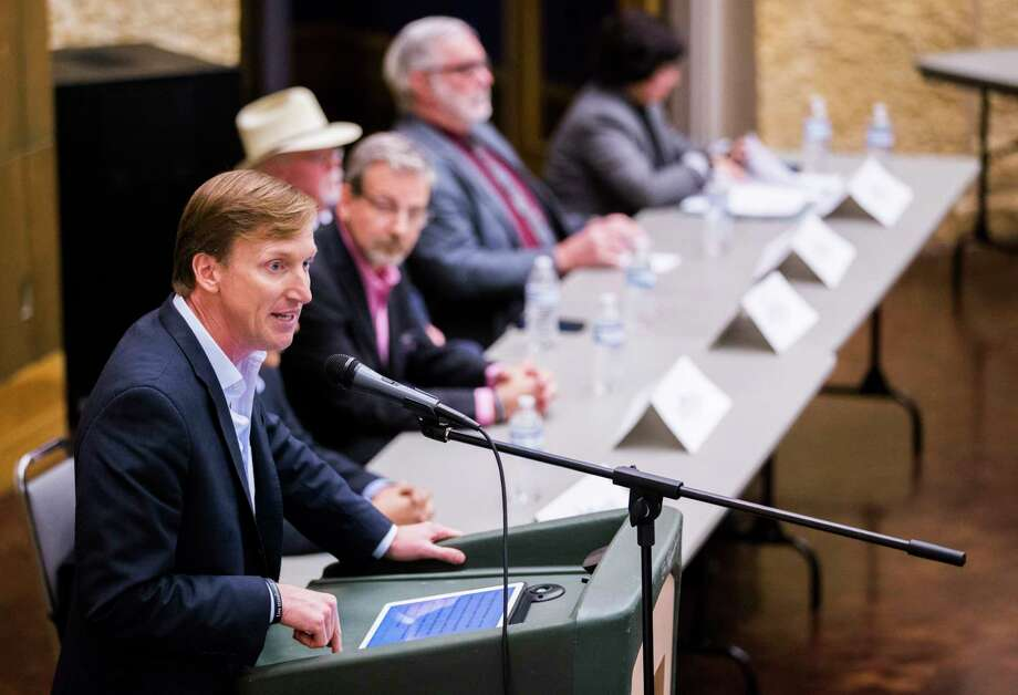 Andrew White, left, speaks about closing a $5 billion property-tax loophole as a way to give Texas teachers a pay raise during a forum hosted by the Tom Green County Democratic Club on Monday. Photo: Ashley Landis, THE DALLAS MORNING NEWS / THE DALLAS MORNING NEWS