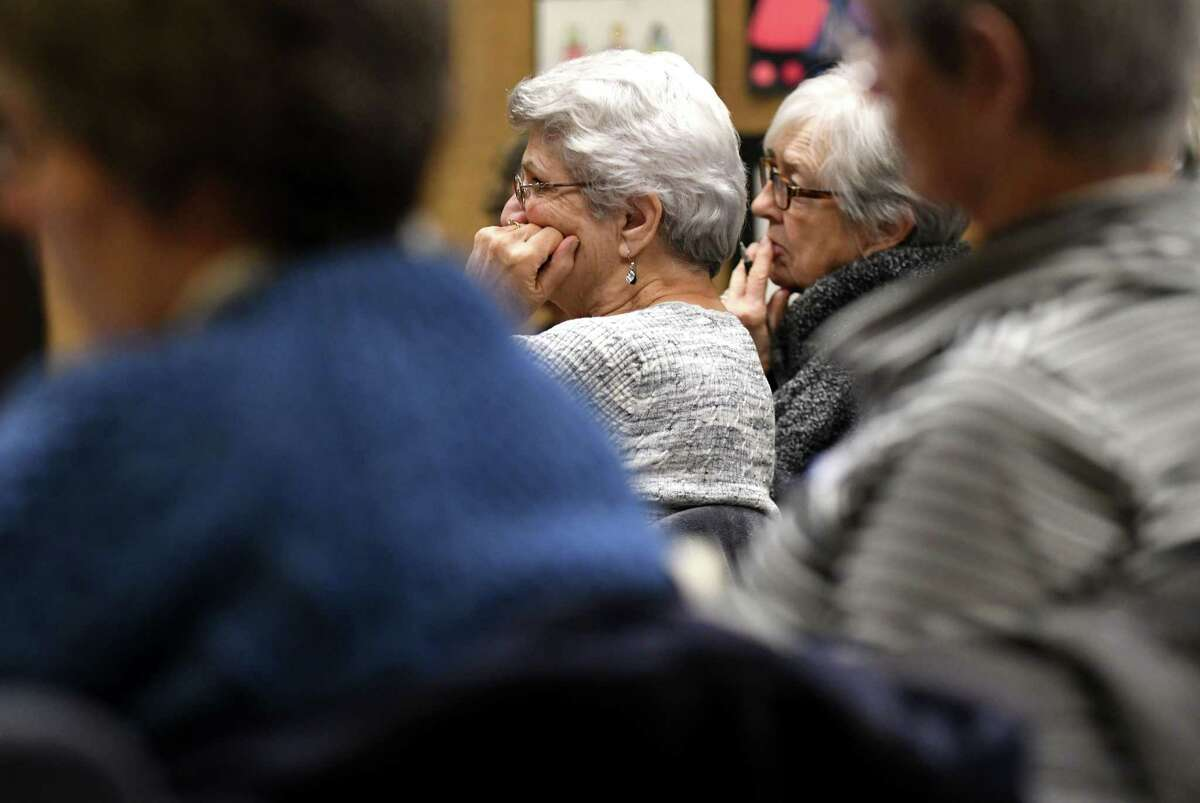 Audience members listen as Amanda Cavanaugh, New York outreach manager for Compassion and Choices, speaks during a meeting hosted Death with Dignity, Albany on Monday, Jan. 8, 2018, at the William K Sanford Town Library in Colonie, N.Y. Death with Dignity is a local supporter of physician-assisted suicide or medical aid in dying. It is launching a campaign to get city and county resolutions in support of state legislation. (Will Waldron/Times Union)