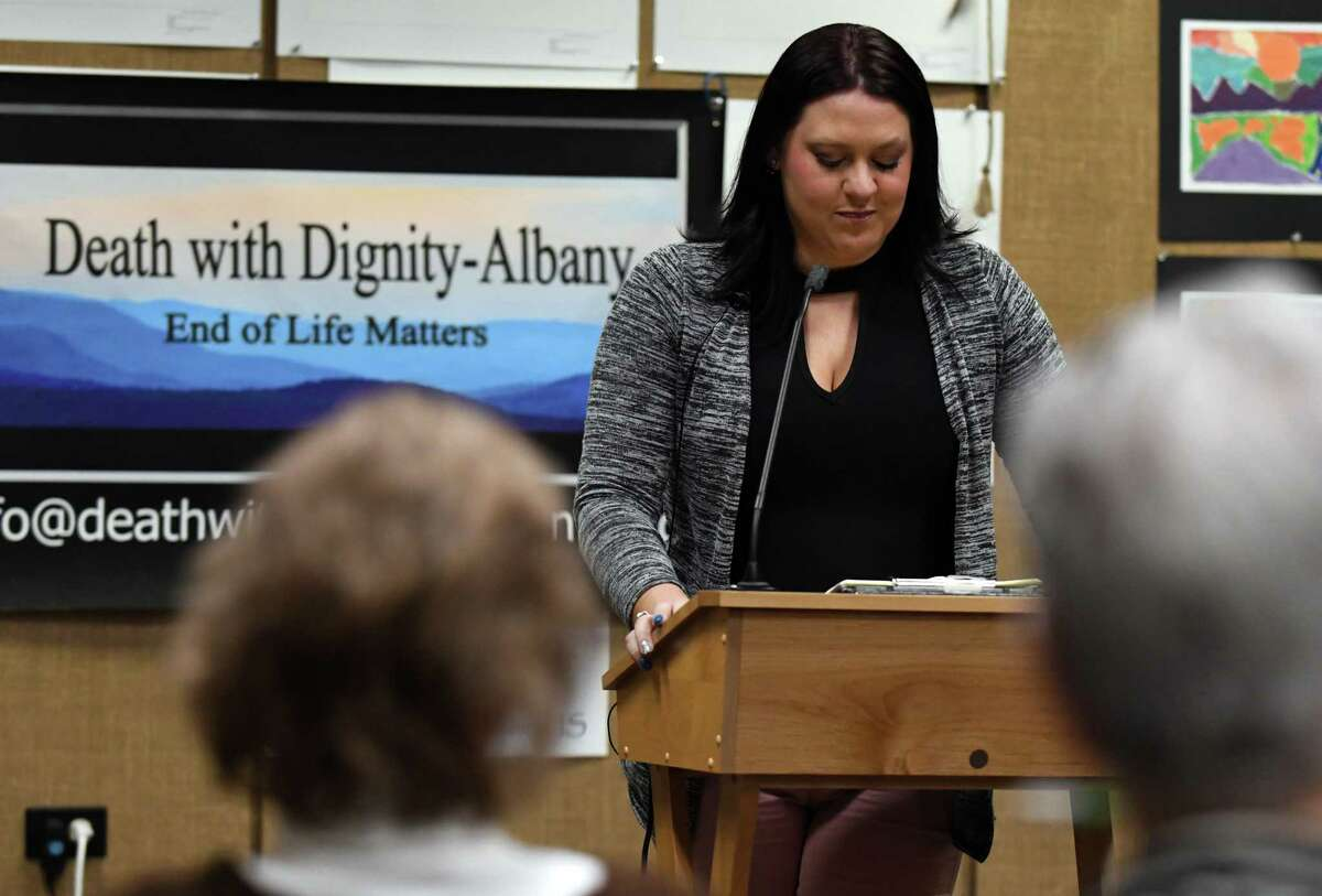 Amanda Cavanaugh, New York outreach manager for Compassion and Choices, speaks during a meeting hosted Death with Dignity, Albany on Monday, Jan. 8, 2018, at the William K Sanford Town Library in Colonie, N.Y. Death with Dignity is a local supporter of physician-assisted suicide or medical aid in dying. It is launching a campaign to get city and county resolutions in support of state legislation. (Will Waldron/Times Union)