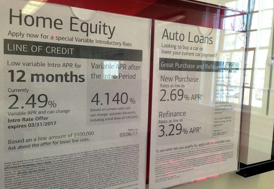 FILE - In this March 6, 2017, file photo, home equity and auto loan rates are displayed at a bank in North Andover, Mass. On Monday, Jan. 8, 2018, the Federal Reserve releases its November report on consumer borrowing. (AP Photo/Elise Amendola, File) Photo: Elise Amendola, STF / Copyright 2017 The Associated Press. All rights reserved.