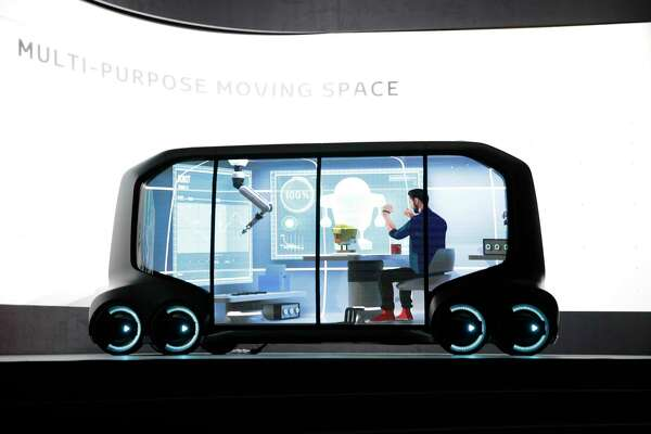 Toyota's e-Pallet vehicles will drive to spots where potential buyers can try on clothes or shoes and have office space on the way.