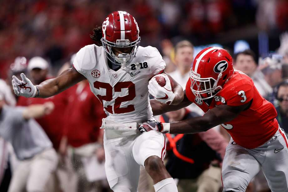 ATLANTA GA- JANUARY 08 Najee Harris #22 of the Alabama Crimson Tide runs the ball against Roquan Smith #3 of the Georgia Bulldogs during the second half in the CFP National Championship presented by AT&T at Mercedes Benz Stadium
