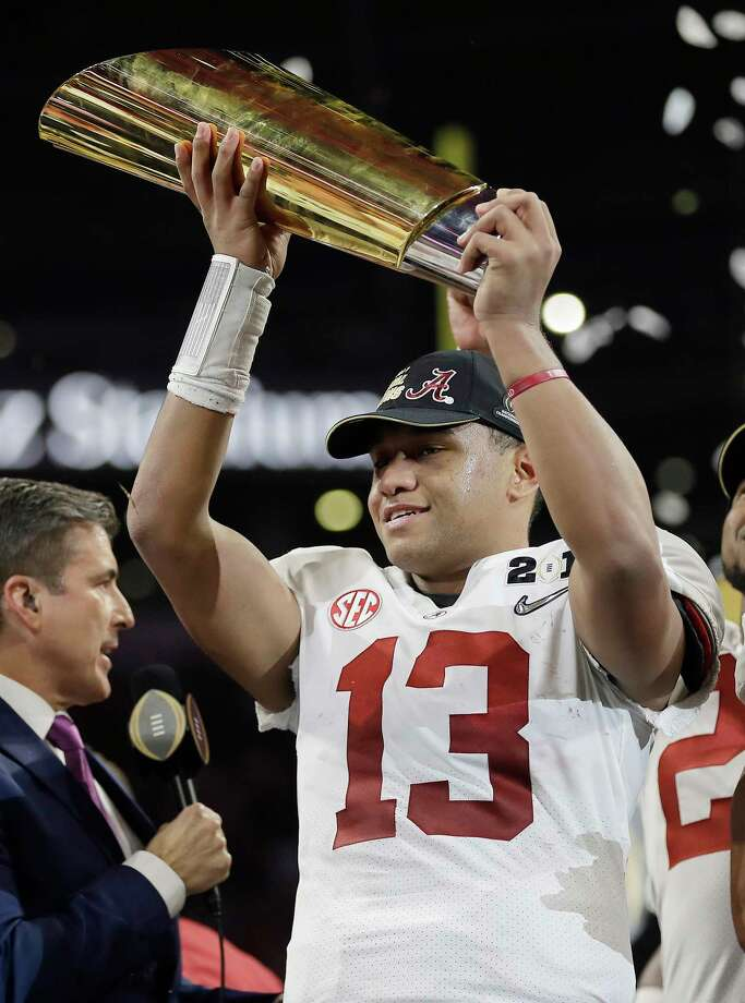Alabama's Tua Tagovailoa holds up the championship trophy after overtime of the NCAA college football playoff championship game against Georgia, Monday, Jan. 8, 2018, in Atlanta. Alabama won 26-23. Photo: David J. Phillip, AP / Copyright 2018 The Associated Press. All rights reserved.