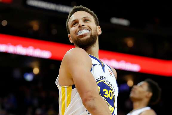 Golden State Warriors' Stephen Curry reacts in 3rd quarter during game against Denver Nuggets at Oracle Arena in Oakland, Calif., on Monday, January 8, 2018.