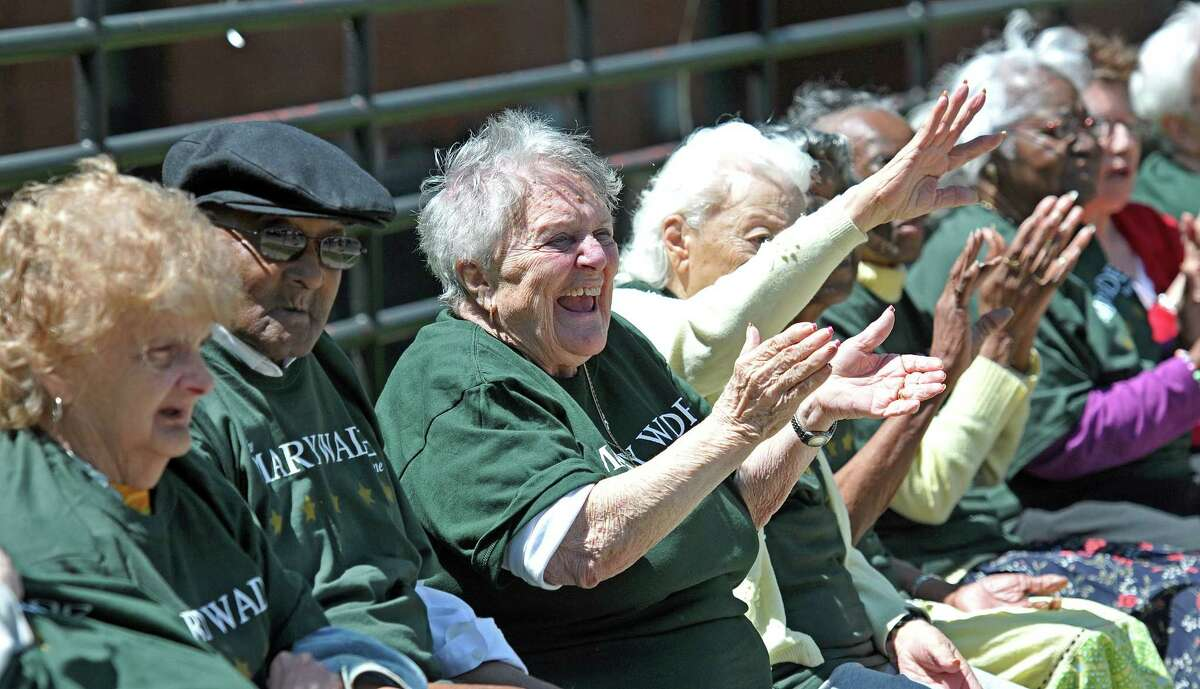 New Haven-- 83-Year-old Rachel Vitelli waves to the parade during the 3rd annual Mary Wade Home Parade along Pine Street. Vitelli lives at the home. . Photo-Peter Casolino/New Haven Register Cas060311 6/3/11