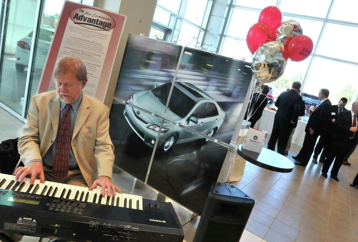 Westbrook--Brad Rickert plays keyboard at Westbrook Toyota's grand opening celebration Thursday. Photo by Brad Horrigan/New Haven Register-04.21.11.