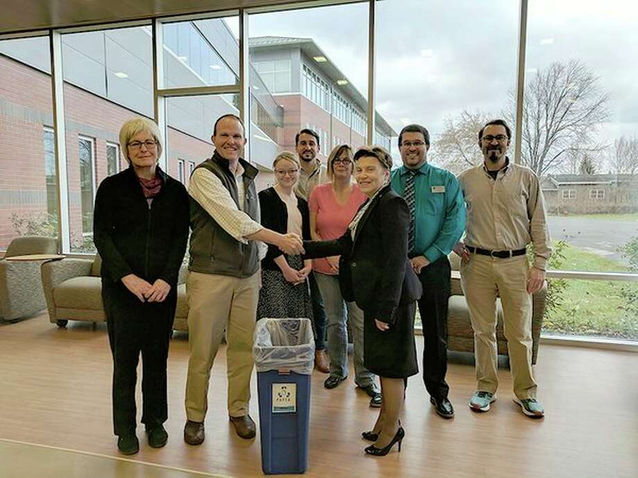 Representatives of Mid Michigan Community College receive a grant from Apex Clean Energy that will be used to improve environmental and clean energy initiatives on campus. (Photo provided)