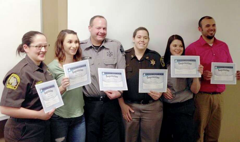 Graduates of the Mid Michigan Community College Local Corrections Officer Training Academy pose for a photo. (Photo provided)