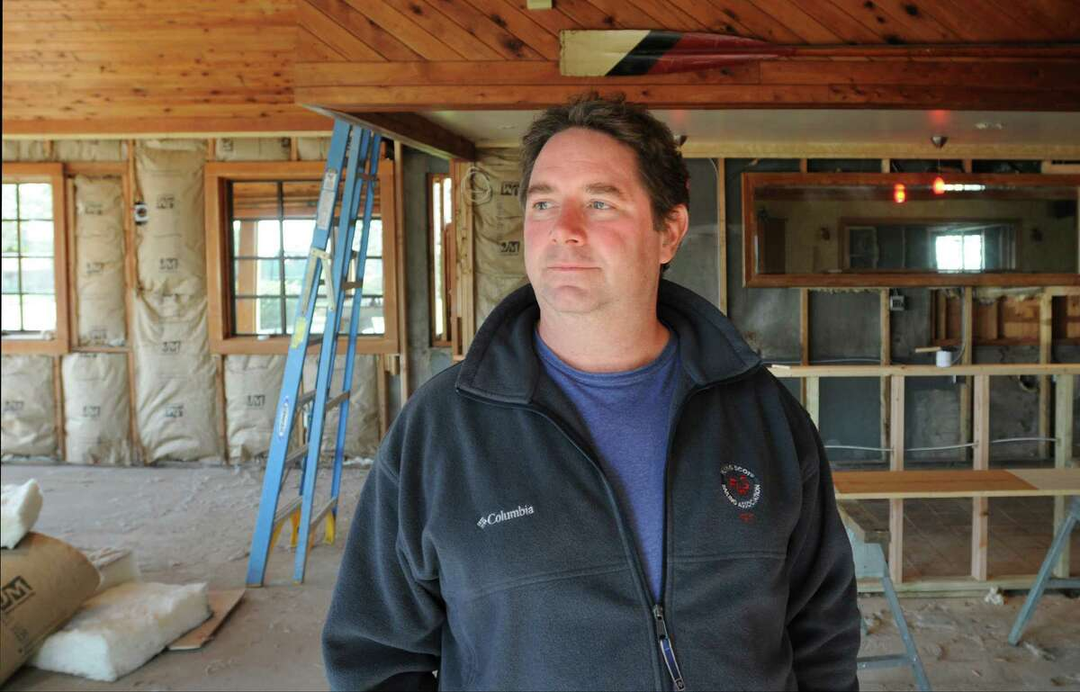 Guilford-- Co-owner Peter Hamme, shown in the bar area of the Stone House Restaurant, that was severely damaged during Tropical Storm Irene. Peter Casolino/New Haven Register. 10/18/11