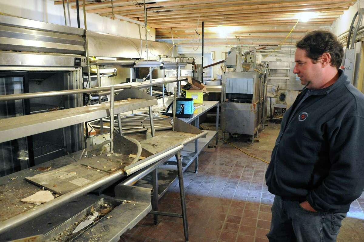 Guilford-- Co-owner Peter Hamme, looks over the damage to the kitchen in the Stone House Restaurant that was severely damaged during Tropical Storm Irene. Peter Casolino/New Haven Register. 10/18/11