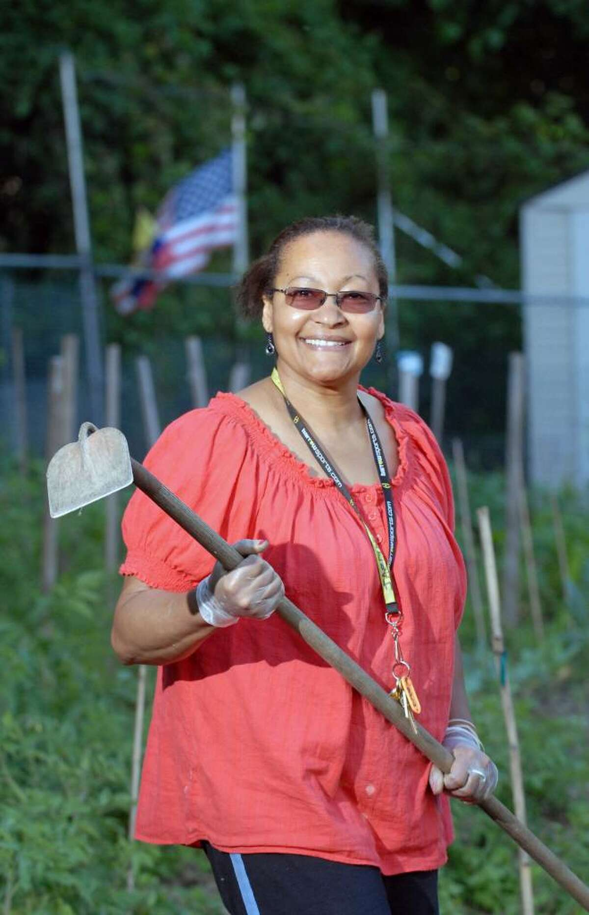 Jocelyne Dorisme, 54, a resident of the Armstrong Court Housing Complex, Byram, poses in the community garden where she tends to her tomatoes, peppers and cabbage, Tuesday evening, June 15, 2010. Dorisme, a naturalized U.S. citizen from Haiti said about July 4th,
