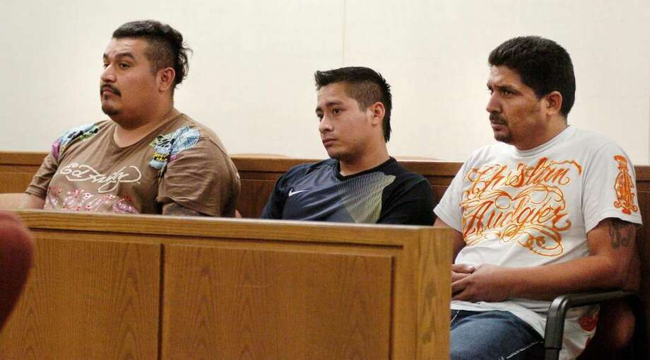Three California men, from left, Alexander Fuentes-Martinez, Manuel Antonio Martinez and Juan Mayorga, charged with burglarizing a Greenwich jewelry store pleaded guilty Thursday, July 1. The men are shown in this file photo being arraigned in September 2009. Photo: File Photo, ST / Greenwich Time File Photo