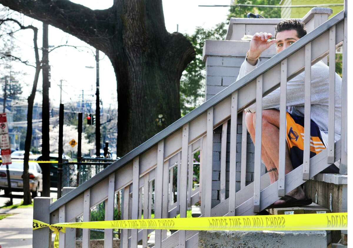 NEW Haven___A witness of a double shooting on Derby Ave. in New Haven says he was sitting on the steps, holding a child, when the shootong took place. He did not wish to be identified. Melanie Stengel/Register