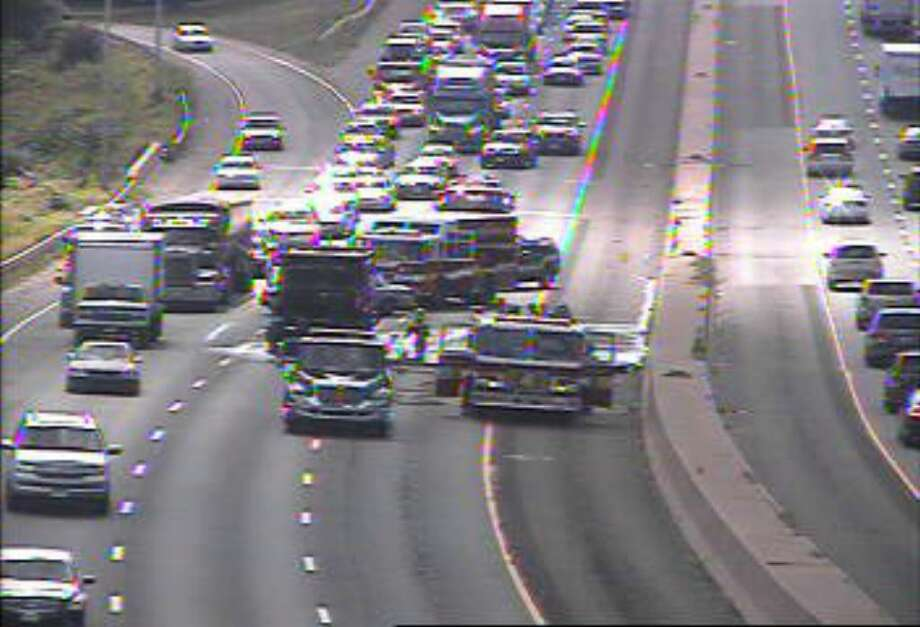 Emergency crews are on the scene of a multi-vehicle crash that briefly shut down Interstate 95 in Fairfield Thursday afternoon near northbound Exit 21, backing up traffic nearly 5 miles into Westport. The image is captured from a state Department of Transportation camera. Photo: Contributed Photo / Fairfield Citizen