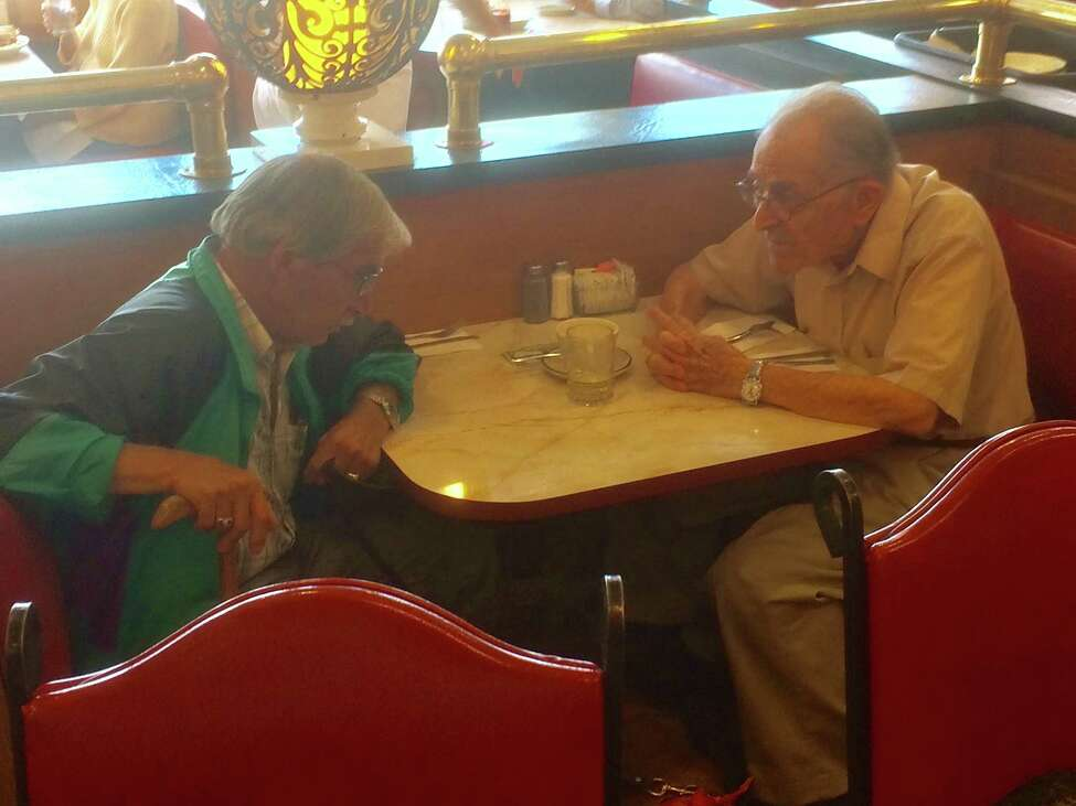 Don Black, right, speaks at the Route 7 Diner with Thomas A. Johnson, who called himself Tommy Little Tree and lied to Black about his military service, Native American heritage and other aspects of his life (Photo courtesy of Steve Black)