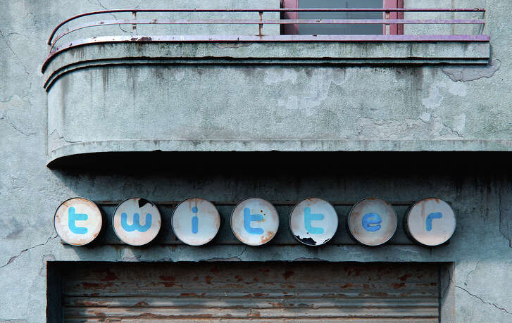 A Romanian artist has reinterpreted the logos for Facebook, Twitter, and Pinterest as distressed signs in a post-apocalyptic world.